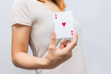 full house: young woman holding in hand poker card with combination of Full House. in focus hand and poker card. Stock Photo