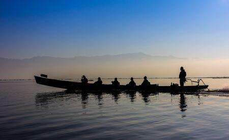 Silhouette of boat at sunset Inle Lake Burma Myanmar Stock Photo - 50868631