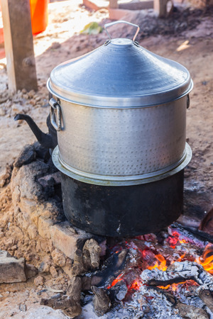 brazier: Rice Cooking with pot on charcoal brazier
