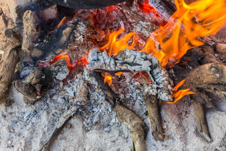 smoldering: Remains of a bonfire, the ash is still smoldering