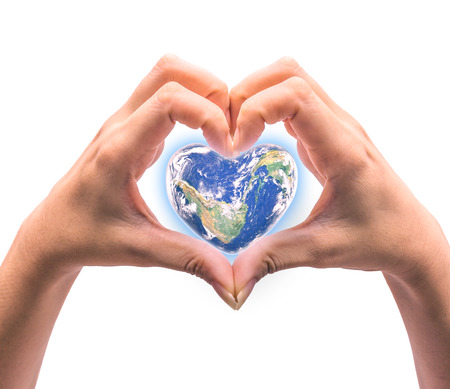 Blue planet in heart shape over woman human hands isolated on white background