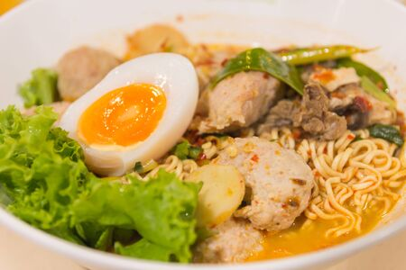 thai noodle soup: Thai noodle soup in a bowl taste spicy noodle soup and boiled egg