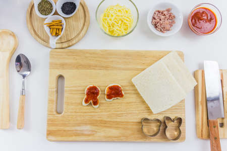 table top: Ingredients for cooking pizza cartoon on wooden table, top view Stock Photo