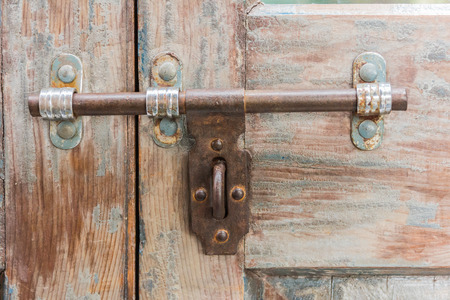 latch: Old latch on a wooden door