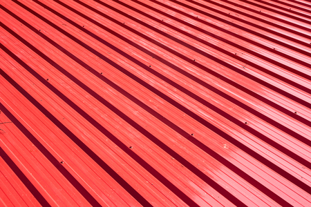 grooved: Red metal sheet for industrial building and construction. Stock Photo