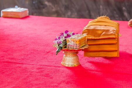 Giving alms to a monk is one of the ways to make money .  Merits Buddhists believe that these good deeds will lead to a better life with more happiness and wealth. Stock Photo