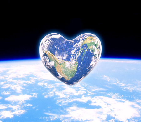 universal love: The earth in the shape of a heart, elements of this image furnished by NASA Foto de archivo