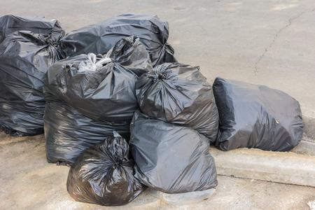 environmental sanitation: Plastic trash bags on outside street office Stock Photo