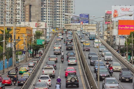 car lots: BANGKOK, THAILAND - June 31, 2016: Traffic reaches gridlock on a busy city centre road. Each year an estimated 150,000 cars join the heavily congested streets of the Thai capital.