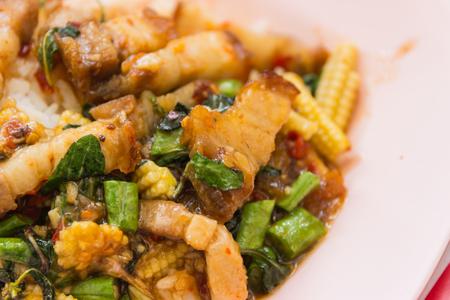santa cena: Traditional Thai dish crispy pork with a fried egg atop the jasmine rice served with chili sauce