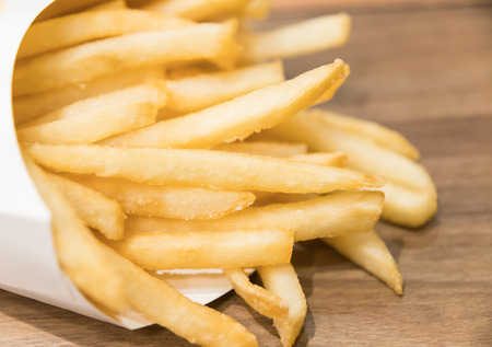 cornet: Selective focus on the front french fries on table Stock Photo