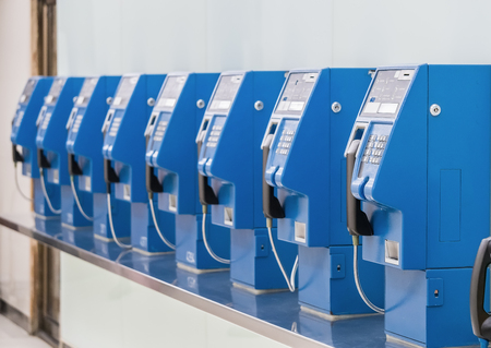 make public: Old and traditional public telephones using the coins to make a call in Bangkok,  Stock Photo