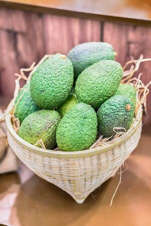 Avocado background. Fresh green avocado on a market stail. Food background.