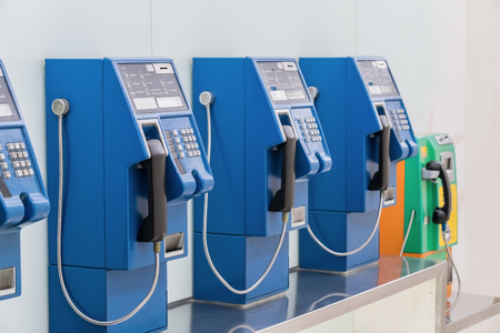 payphone: Old and traditional public telephones using the coins to make a call in Bangkok,  Stock Photo