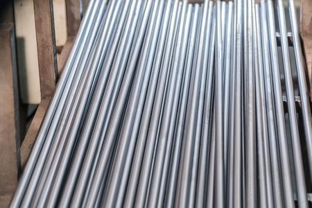 A metallic pipe striped background