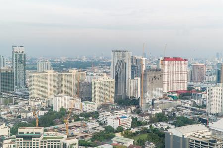 atmospheric: Bangkok, Thailand - March 13, 2017 : Bangkok Skyline With City office building at sunset Bangkok, Thailand