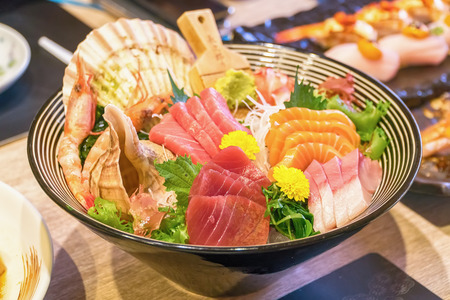 Fresh Salmon and seafood don, close up, seafood bowl Set of Fresh salmon rice with Wahhabi and sauce, Japans traditional food