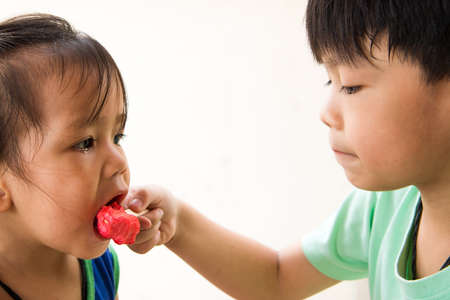 boy and girl eating their favorite ice cream.