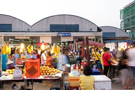 PATHUM THANI/Thailand - Mar 22, 2018: Many people are shopping for food at Sapandeang's market in the evening.