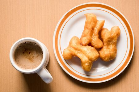 Thai style breakfast is a cup of coffee and deep fried crispy dough called Pa-Tong-Go, in the morning. Refresh your brain with caffeine for ready to work.