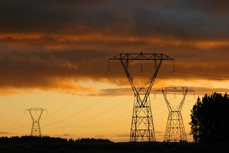 Electric towers and national power line. Dramatic sunset on the background.