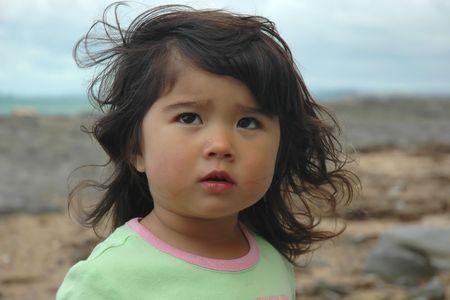 Cute little girl having one single tear-drop. Portrait. photo