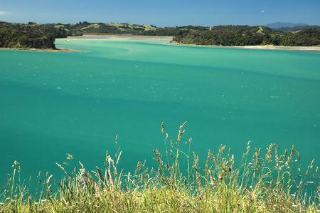 Perfect vacation image - Green sea, beach, blue sky, islands, bays,  sunshine. Like a paradise. Tourist attraction Mahurangi national park, New Zealand