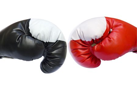 boxing match: Red and black two boxing gloves competition sparring isolated over white