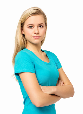 Portrait of confident young woman standing against white background  Vertical shot  Stock Photo