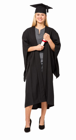 Full length portrait of college student in graduation gown holding certificate against white background  Vertical shot  photo