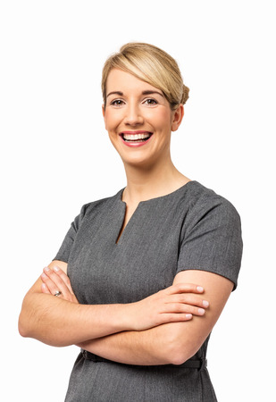 Portrait of smiling young businesswoman with arms crossed isolated over white background  Vertical shot  photo