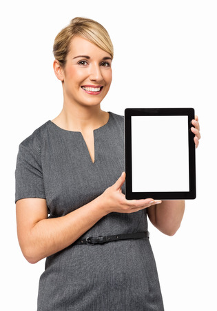 three persons only: Portrait of confident young businesswoman showing digital tablet isolated over white background  Vertical shot