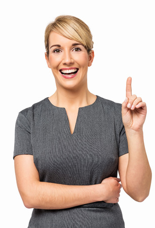 Portrait of happy young businesswoman with an idea pointing up isolated over white background  Vertical shot
