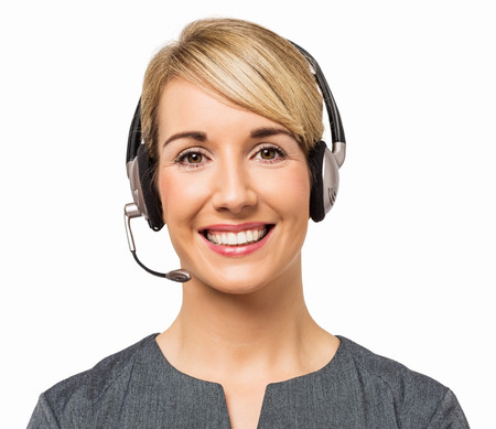 Portrait of happy female call center representative wearing headset isolated over white background  Horizontal shot