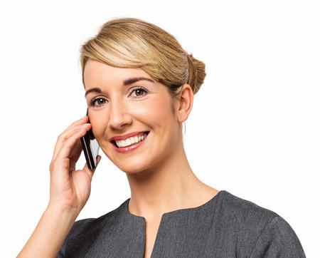 Portrait of happy businesswoman answering smart phone against white background. Horizontal shot. photo