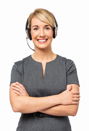 Portrait of happy customer service representative wearing headset isolated over white background. Vertical shot.