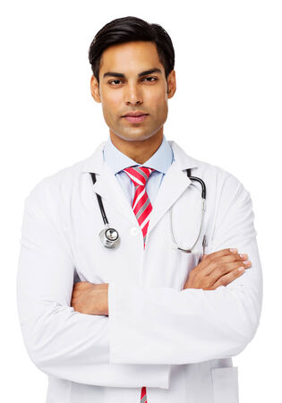 young male doctor: Portrait of confident young male doctor with arms crossed standing against white background. Vertical shot.