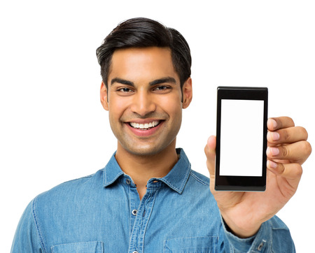 Portrait of happy young man showing smart phone over white background. Horizontal shot. photo