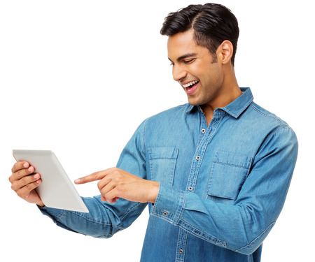 Happy young man using digital tablet against white background. Horizontal shot. photo