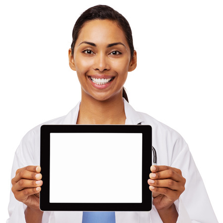 Portrait of happy female doctor promoting digital tablet against white background. Horizontal shot. photo