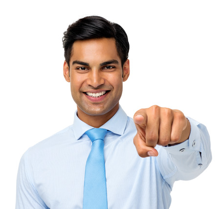 Portrait of happy young businessman pointing at you over white background. Horizontal shot. photo
