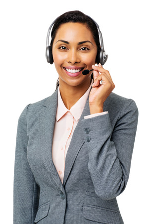 Portrait of beautiful call center representative wearing headset over white background. Vertical shot. photo