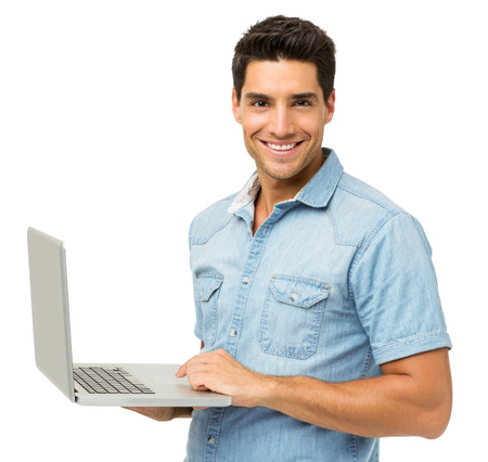 Portrait of smiling young man with laptop isolated over white background. Horizontal shot.