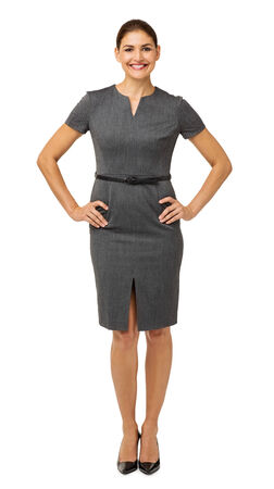 Full length portrait of smiling businesswoman with hands on hips isolated over white background. Vertical shot. photo