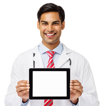 Portrait of confident male doctor showing digital tablet over white background. Horizontal shot. photo