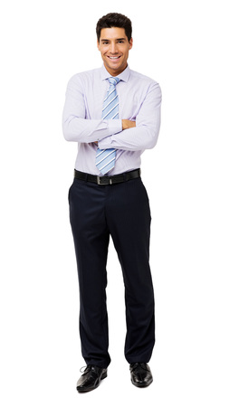Full length portrait of smiling businessman standing arms crossed over white background. Vertical shot.