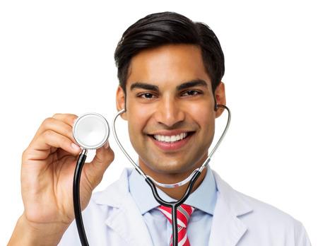 Portrait of smiling male doctor holding stethoscope isolated over white background. Horizontal shot. photo