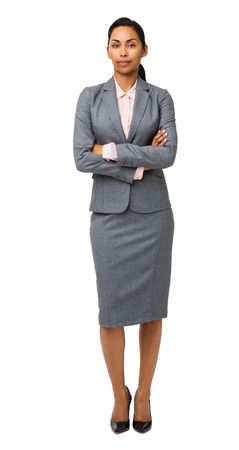 Full length portrait of confident businesswoman standing arms crossed over white background. Vertical shot. photo