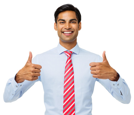 Portrait of happy young businessman gesturing thumbs up over white background. Horizontal shot. photo