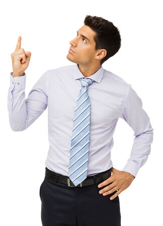 Young businessman pointing upwards isolated over white background. Vertical shot. photo
